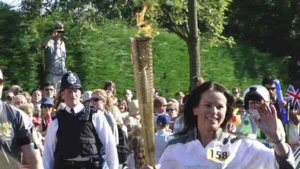 Олимпийский огонь прибыл на корт Уимбилдона