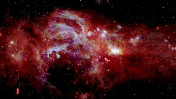 Составное инфракрасное изображение центра нашей галактики Млечный Путь, охватывающее более 600 световых лет