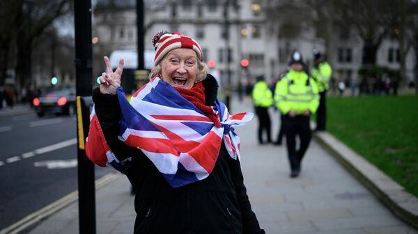 Сторонница Brexit на торжественных мероприятиях, посвященных выходу Великобритании из ЕС (Brexit Party) на площади Парламента в Лондоне