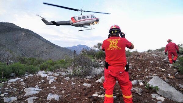 Работа спецслужб на месте крушения самолета с мексиканской певицей Дженни Ривера на борту