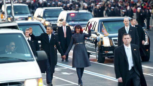 Барак и Мишель Обама во время инаугурационного парада в Вашингтоне