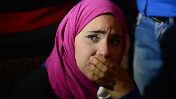 Родственница погибшего в давке в египетском Порт-Саиде, архивное фото