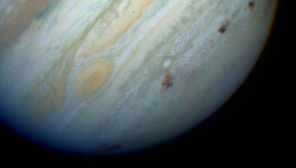 Следы падения обломков кометы Шумейкера-Леви 9 в южном полшарии Юпитера