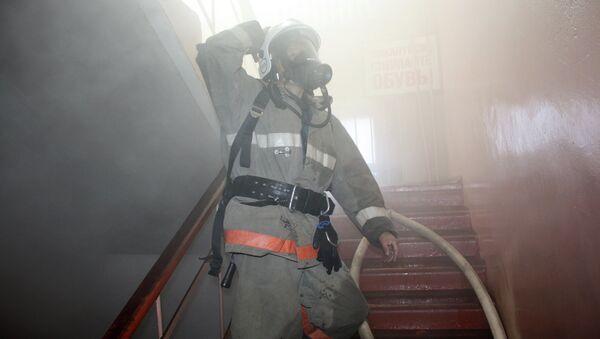 Тушение пожара в подвале административного здания в Горно-Алтайске