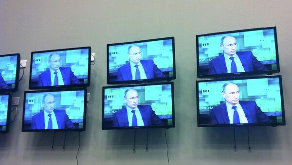 Президент РФ Владимир Путин в эфире Russia Today