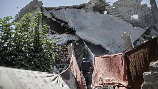 Бои в районе Барзе провинции Дамаск. Архивное фото