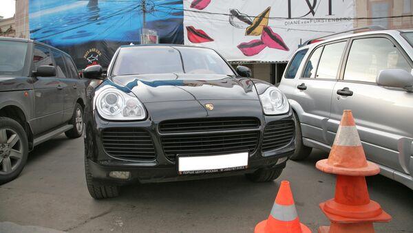 Автомобиль Porsche Cayenne. Архивное фото
