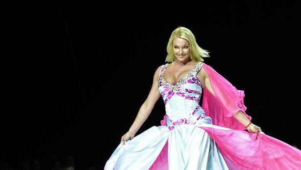 Балерина, танцовщица и общественный деятель Анастасия Волочкова демонстрирует одежду из новой коллекции марки YanaStasia