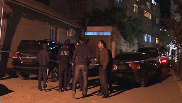 Сотрудники правоохранительных органов работают на месте убийства. Архивное фото
