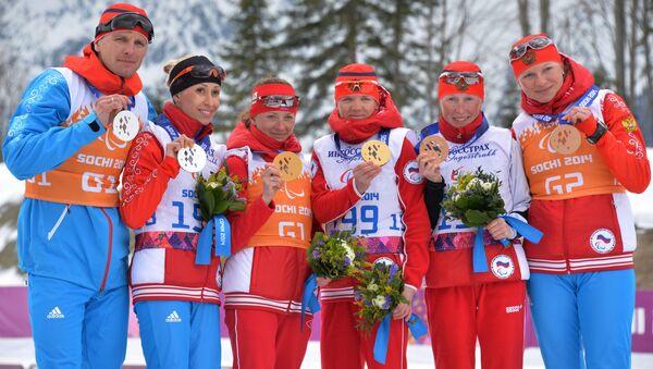 Призеры гонки на дистанции 5 км в классе B 1-3 (слабовидящие) среди женщин в соревнованиях по лыжным гонкам на XI Паралимпийских зимних играх в Сочи. Архивное фото