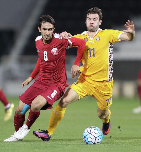 Игровой момент матча Катар - Молдавия