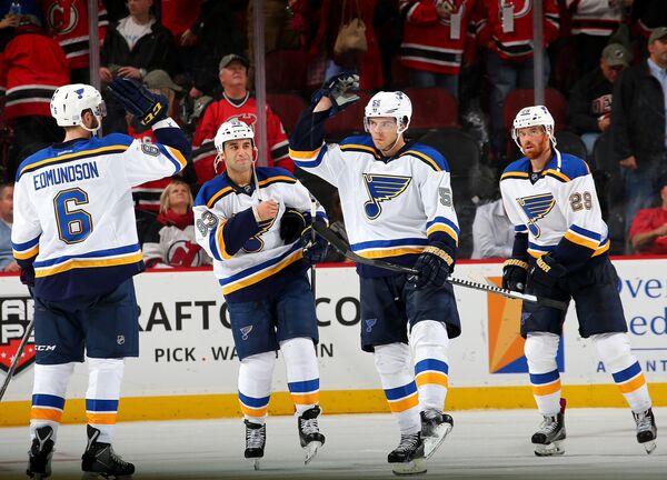 Хоккеисты Сент-Луис Блюз Джоэл Эдмундсон, Скотт Гомес, Магнус Пяярви и Мартин Гавлат (слева направо), архив/2015 год