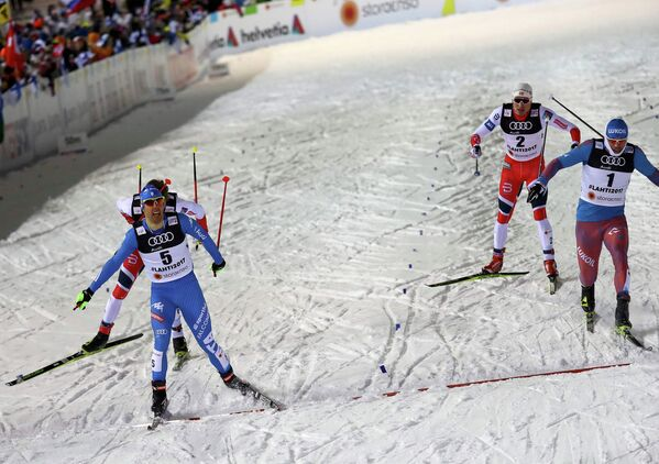 Федерико Пеллегрино (Италия) и Сергей Устюгов (Россия) (слева направо на первом плане)