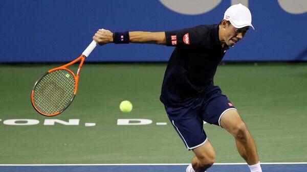 Японец Кэй Нисикори во время матча третьего раунда теннисного турнира в Вашингтоне