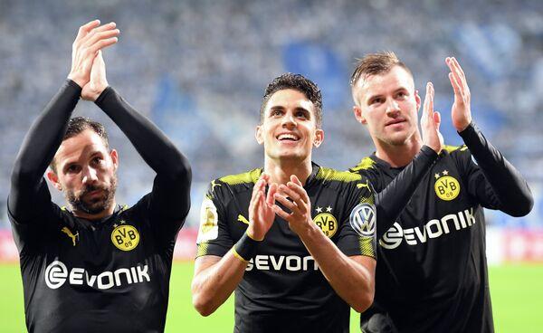 Футболисты дортмундской Боруссии Гонсало Кастро, Марк Бартра и Андрей Ярмоленко (слева направо)