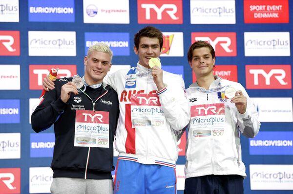 Итальянец Симоне Саббиони, россиянин Климент Колесников и румын Роберт-Андрей Глинцэ (слева направо)