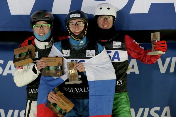 Ци Гуанпу, Максим Буров и Антон Кушнир (слева направо)