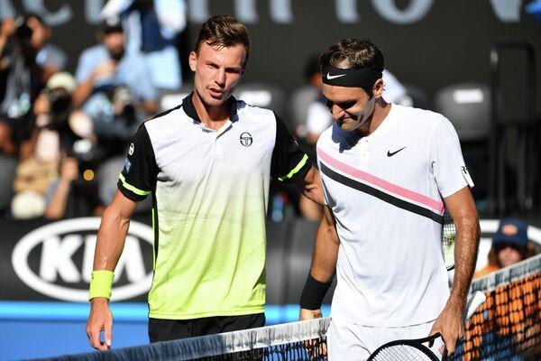 Мартон Фучович и Роджер Федерер (слева направо)