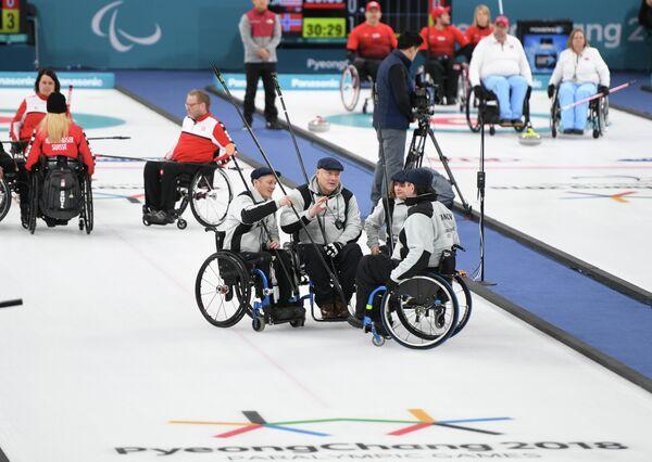 Российские атлеты Константин Курохтин, Марат Романов, Александр Шевченко и Дарья Щукина (слева направо на первом плане)