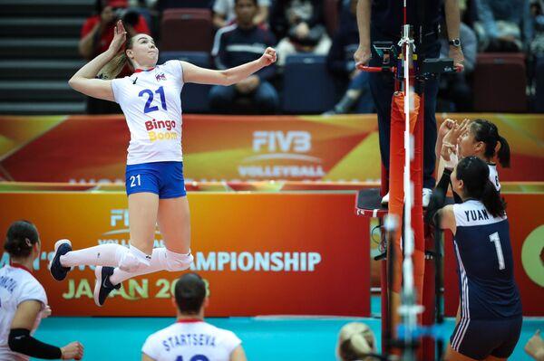 Игровой момент матчам женского ЧМ по волейболу Россия - Китай