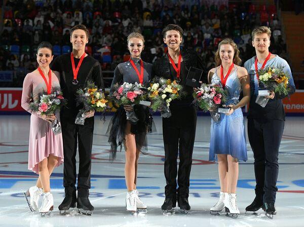 Сара Уртадо и Кирилл Халявин, Александра Степанова и Иван Букин, Кристина Каррейра и Энтони Пономаренко (слева направо)