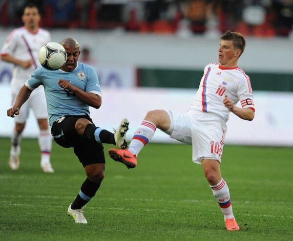 Игровой момент матча сборных России и Уругвая