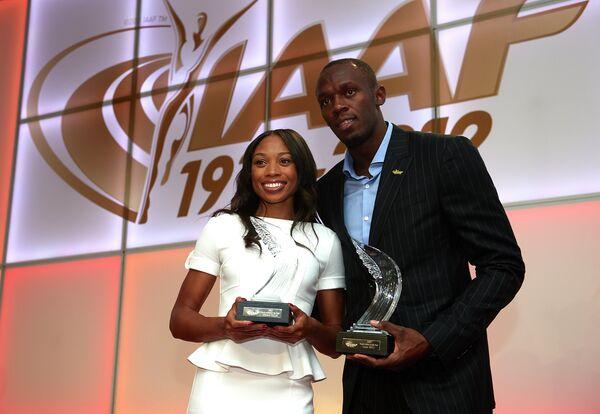 Ямайский спринтер Усэйн Болт и американская бегунья Эллисон Феликс