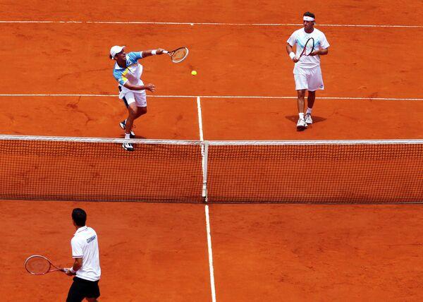 Аргентинцы Орасио Себальос и Давид Налбандян (сверху слева направо)