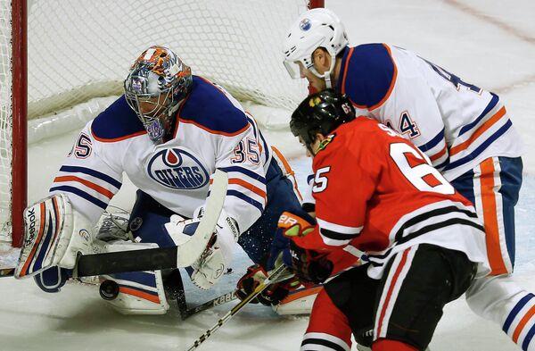 Игровой момент матча НХЛ Чикаго - Эдмонтон