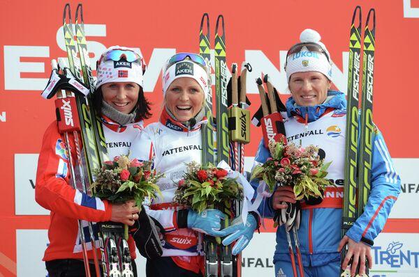 Марит Бьорген, Тереза Йохауг и Юлия Чекалева (слева направо)