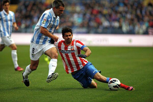 Игровой момент матча Малага - Атлетико (Мадрид)