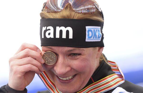 Немка Клаудиа Пехштайн, завоевавшая бронзовую медаль в женском забеге на 5000 м