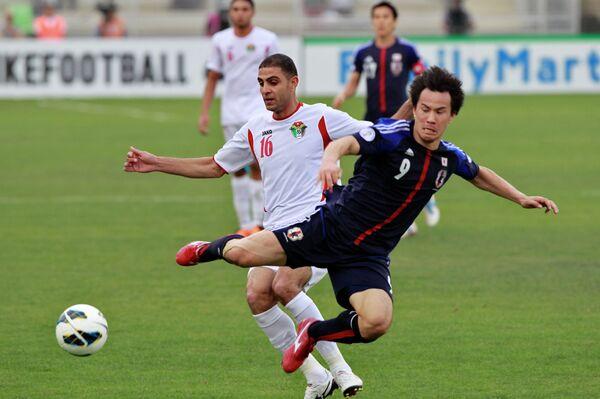 Игровой момент матча Япония - Иордания