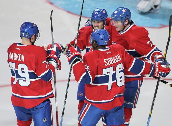 Хоккеисты Монреаль Канадиэнс Брайан Джионта, Андрей Марков, Пи Кей Суббан