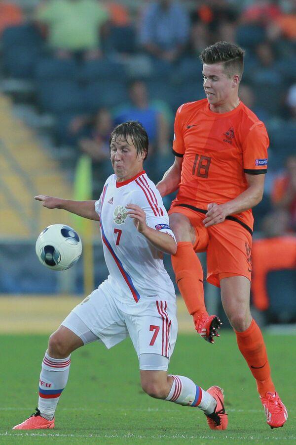 Марко ван Гинкел (справа)