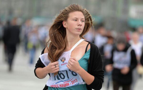 Участница массового забега Кросс нации - 2013 в Казани