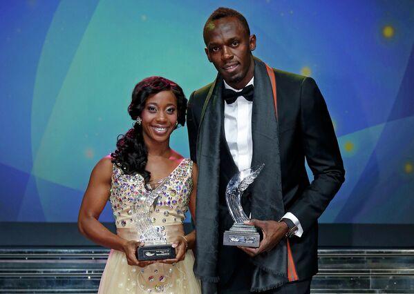 Ямайские спринтеры Шелли-Энн Фрэйзер-Прайс и Усэйн Болт на церемонии награждения легкоатлета года по версии IAAF
