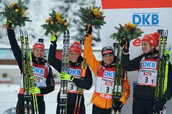 Немецкие спортсменки Лаура Дальмайер, Франциска Хильдебранд, Андреа Хенкель и Франциска Пройс (слева направо)