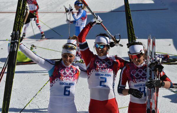 Шарлотт Калла, Марит Бьорген и Венг Хейди (слева направо)