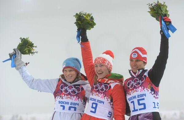 Тура Бергер, Дарья Домрачева и Тея Грегорин (слева направо)