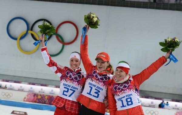 Селина Гаспарин, Дарья Домрачева и Надежда Скардино (слева направо)
