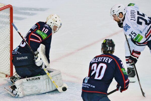 Игровой момент матча Сибирь - Металлург