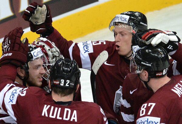 Хоккеисты сборной Латвии Земгус Гиргенсонс, Артур Кулда, Андрис Джериньш и Гинтс Мейя (слева направо)