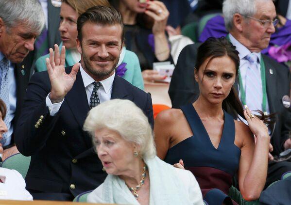 Дэвид и Виктория Бекхэм (слева направо) на финале Уимблдонского теннисного турнира