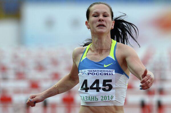 Светлана Топилина - победительница в беге на 100 метров с барьерами