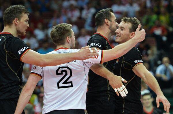 Волейболисты сборной Германии Кристиан Фромм, Маркус Штойервальд, Георг Грозер, Денис Калиберда (слева направо)