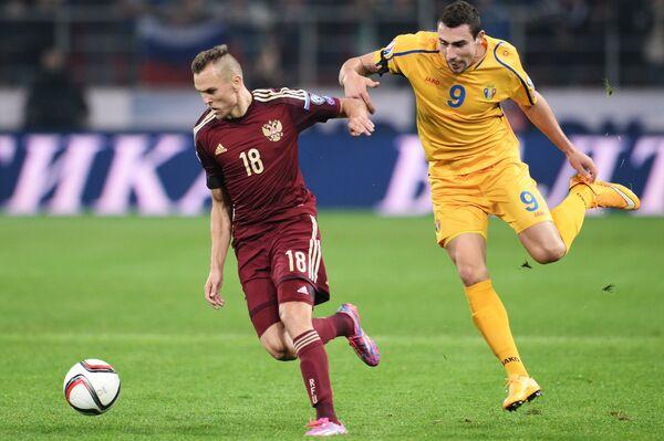 Денис Черышев (слева) и Артур Ионица