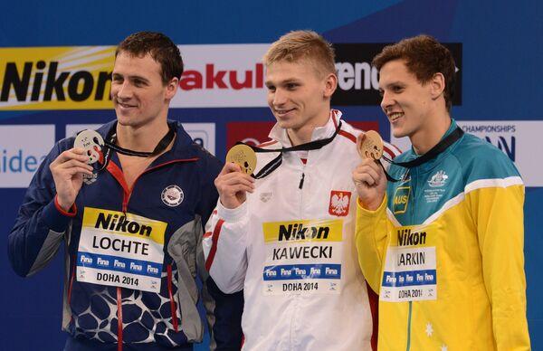 Райана Лохте,  Радослав Кавецкий и Митчелл Джеймс Ларкин (слева направо)