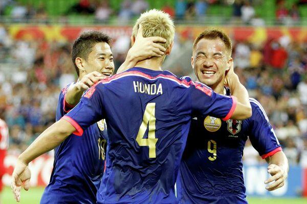 Футболисты сборной Японии Синдзи Кагава, Кэйсукэ Хонда и Синдзи Окадзаки
