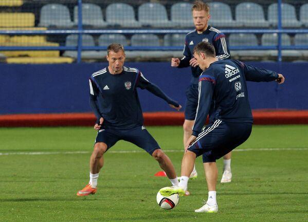 Василий Березуцкий, Иван Новосельцев и Артем Дзюба (слева направо)